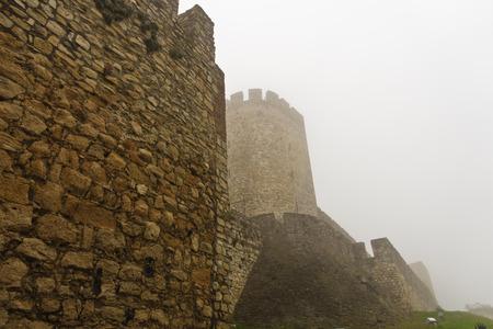 View of Kalemegdan fortress at fog from below fortress walls, Belgrade, Serbia
