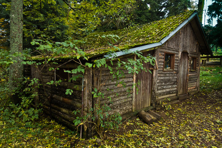 Wooden hut in a forest at mountain Goc in Serbia Stock Photo