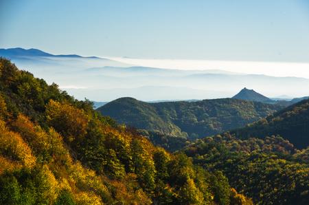 Autumn fog is rolling between hills of Zeljin mountain, Serbia