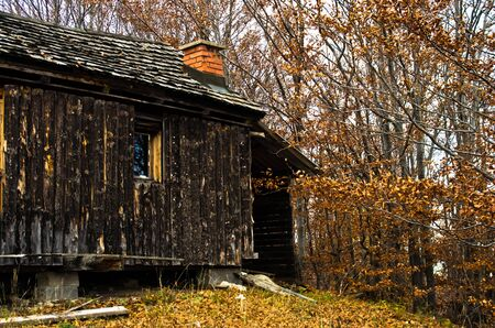 Old wooden cabin at autumn sunset, Bobija mountain, west Serbia