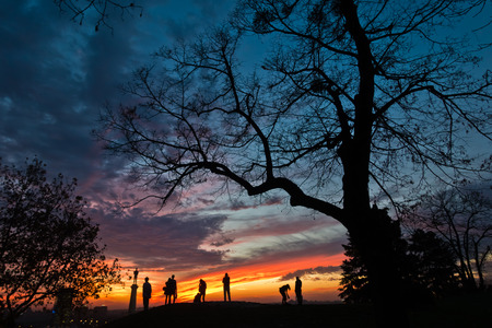 belgrade: Silhouette of a group of people at colorful sunset over Kalemegdan park in Belgrade, Serbia Stock Photo