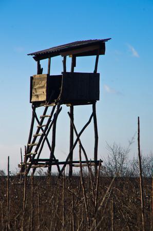 Hunting watchtower on a meadow at sunny autumn day, Deliblatska pescara, Serbia Stock Photo