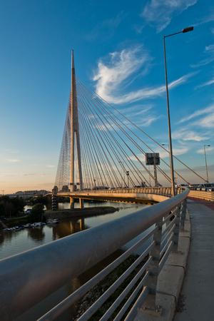 Cable bridge over Sava river at sunset in Belgrade, Serbia Stock Photo