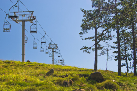 Ropeway at Divcibare mountain against blue sky, west Serbia Stock Photo