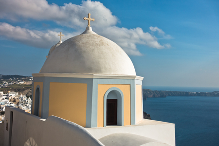 Dome of a church at Oia village with view on Caldera at background, Santorini island, Greece