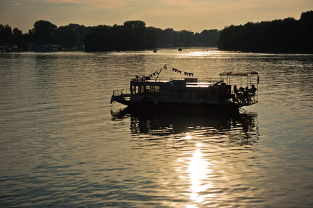 confluence: Lovely boat at sunset, confluence of Sava and Danube river in Belgrade, Serbia