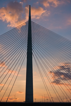 Silhouette of a huge cable bridge over Sava river at sunset in Belgrade, Serbia