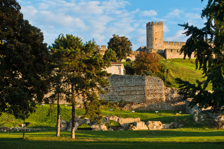 A view from a park to Kalemegdan fortress walls and towers at sunset, Belgrade, Serbia Editorial