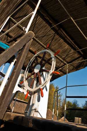 Rudder wheel of a ship on a sunny morning at protected natural swamp area of Carska bara, large natural habitat for birds and other animals in north Serbia