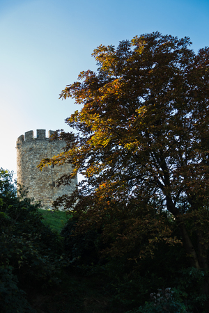 Kalemegdan fortress tower on a hill, view from a park behind the trees, Belgrade, Serbia Stock Photo