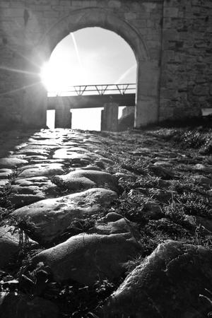 Cobblestone path, gate, walls and wooden bridge inside Kalemegdan fortress in Belgrade, Serbia