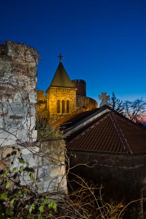 Church tower inside Kalemegdan fortress walls at blue hour in Belgrade, Serbia Stock Photo