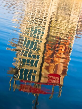 belgrade: Reflection of a building in a lake at sunset, Ada, Belgrade, Serbia