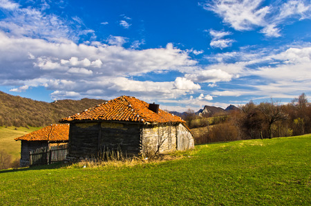 and hiking path: Meadows and hills,  Homolje mountains landscape on a sunny day in early spring, east Serbia