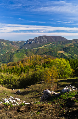 Viewpoint on a landscape of mount Bobija, peaks, hills, rocks, meadows and colorful forests, west Serbia Stock Photo