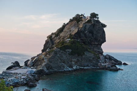 The church of Agios Ioannis Kastri on a rock at sunset, famous from Mamma Mia movie scenes, Skopelos Island, Greece