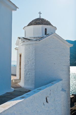 Small white church on a hill over Skopelos town at summer morning, island of Skopelos, Greece Stock Photo