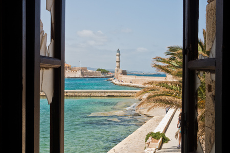 A view of a lighthouse at the old Venetian harbor, city of Chania, Crete island, Greece