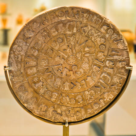 Phaestos disk with unknown script exibited at Heraklion archaeology museum, island of Crete, Greece Stock Photo