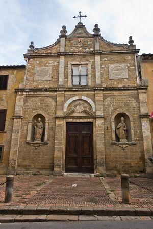 Entrance to small church chiesa di San Pietro in Selci near Fortezza Medicea in Voltera, Tuscany, Italy Banco de Imagens