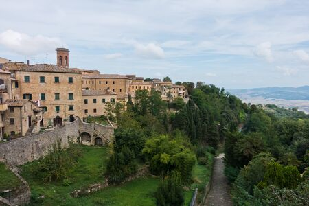 Cityscape and surrounding landscape, a view from city walls of Voltera in Tuscany, Italy Banco de Imagens