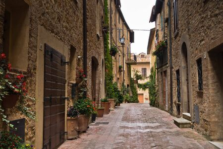 Narrow streets with romantic medieval architecture at city of Pienza, Siena province, Tuscany, Italy