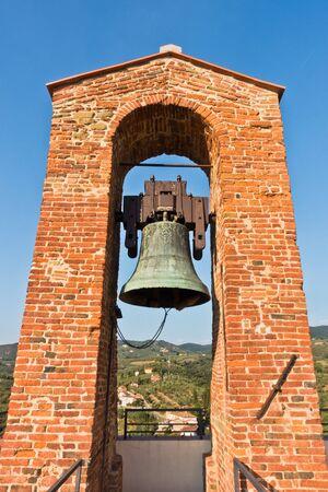 Bell tower at Castello dei Conti Guidi in Vinci, Tuscany, Italy Banco de Imagens