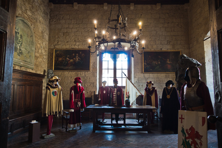 Clothes, coat of arms and other heraldic details inside Priori Pallace in Volterra, which is the oldest city council hall in Tuscany, Italy Editorial