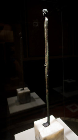 Artistic details of thin boy from Etruscan public museum in Volterra, Tuscany, Italy