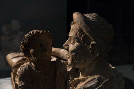 Artistic details of a married couple from Etruscan public museum in Volterra, Tuscany, Italy