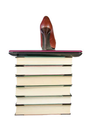 Books, laptop and a high heel - necessary elements of a modern woman photo