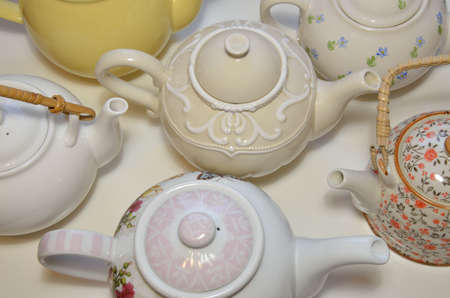 Different types of vintage teapots, from bird photo