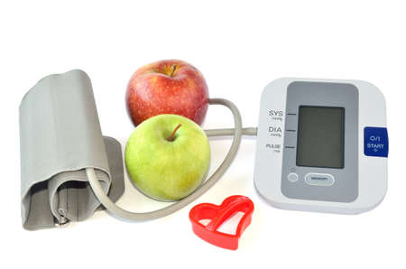 Two apples, blood pressure monitor and heart photo