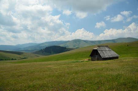 shepards: Shepards house in green mountain fields Stock Photo