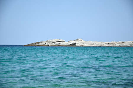 cay: Turquoise sea water, clear blue sky and cay Stock Photo