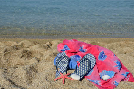 pareo: Summer pareo scarf and flip flops with blue sea in background