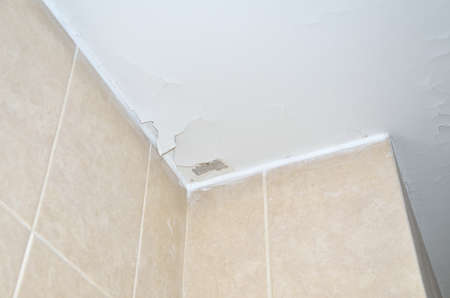 Cracks on ceiling stucco with a concrete place without stucco material