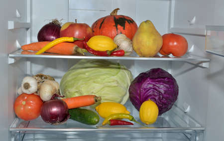 stocked: Two refrigerator shelves with fresh fruits and vegetables