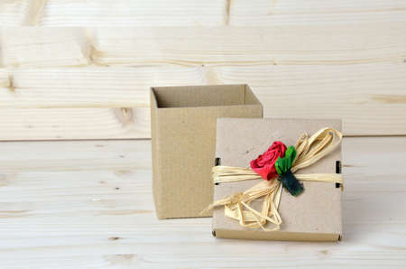 rose: Opened gift cardboard box with red paper rose on its lid
