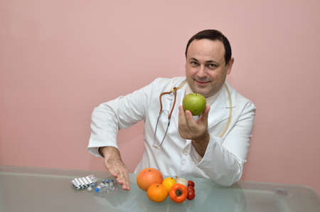 recommending: Doctor recommending fresh healthy food instead of taking drugs Stock Photo