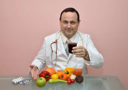 recommending: Doctor recommending fresh made natural juices and healthy food instead of taking pharmaceutical products