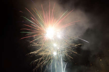 glow pyrotechnics: Big fireworks on the night sky in residential area Stock Photo