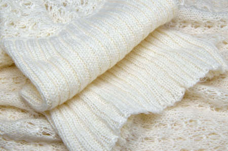 lavish: Knitted white woolen sweater with focus on its lavish turtleneck