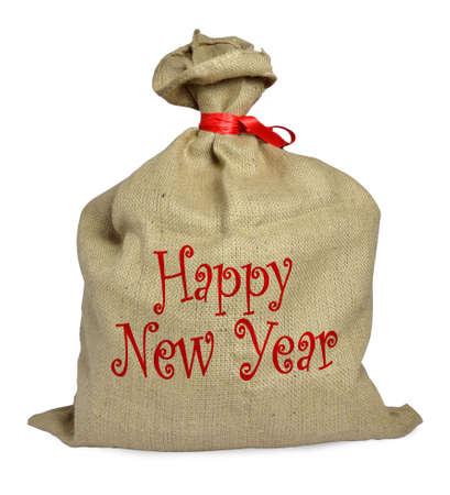 sacco juta: sacco di iuta con il nastro rosso su sfondo bianco con la didascalia 'Happy New Year'