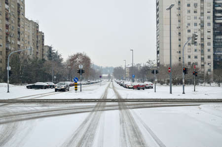 weather: Crossroad of two city streets covered with snow