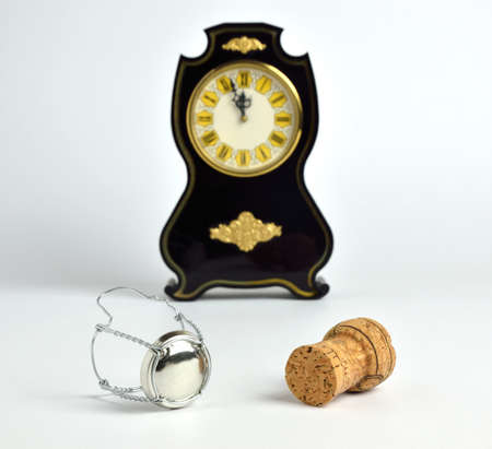 o'clock: Champagne cork and clock showing five minutes to twelve oclock