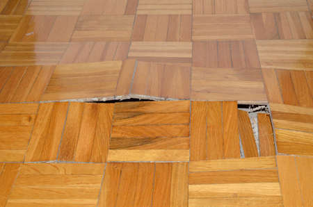 Wooden Floor In Apartment With Floor Damaged By Destructive Elements