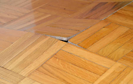 Ruined wooden floor by moisture and water.