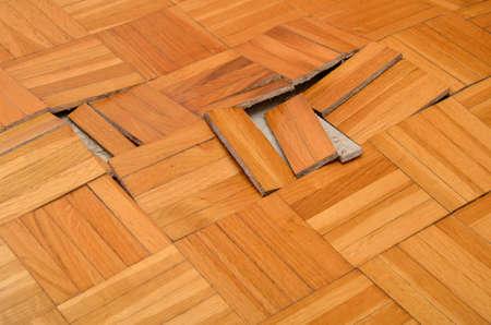 destructive: Wooden floor in apartment damaged by destructive elements such as wet, moisture, water. Stock Photo
