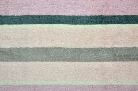 Terry fabric with stripes in pink and grey color as background Imagens